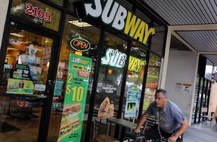 A man outside a Subway restaurant in Miami, Florida.