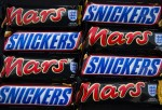 In this photo illustration Mars and Snickers chocolate bars are seen on February 23, 2016 in Bristol, England. Mars Inc., which owns both brands, has announced a recall of chocolate products in 55 countries following the discovery of bits of plastic in a