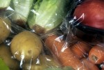 Unnecessary packaging - clear plastic and cellophane wrapping on vegetables sold in supermarket. Researchers at the National University of Singapore have developed a novel packaging material that doubles food shelf-life.