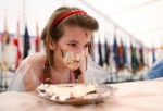 A young girl takes part in a cake eating contest during the Fourth of July festivities at the Baumholder U.S. military base on July 4, 2012 in Baumholder, Germany.