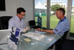 Caddie Phil Morbey undergoes a cholesterol test with a consultant after the pro - am before the Portugal Masters at the Oceanico Victoria Golf Course on October 13, 2010 in Faro, Portugal.