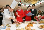Crew members of China Southern Airlines choose food that will be provided on their first direct flights from Guangzhou to Taiwan, at a restaurant of the carrier January 26, 2005 in Guangzhou of Guangdong Province, China.