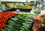 Various fruit and vegetables on the shelves at a l